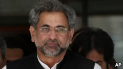 Pakistan's premier-designate Shahid Khaqan Abbasi leaves after meeting with politicians in Parliament house in Islamabad, Pakistan, Monday, July 31, 2017. Pakistan's parliament will meet Tuesday to elect a new prime minister after the disqualification of three-term prime minister Nawaz Sharif. Sharif's Pakistan Muslim League party nominated Sharif's longtime loyalist Abbasi for the top slot on Saturday. (AP Photo/Anjum Naveed)