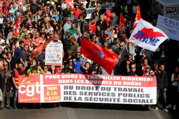 Demonstrators, holding CGT labour union flags, attend a national strike and protest against the government's labour reforms in Marseille, France, September 12, 2017.    REUTERS/Jean-Paul Pelissier