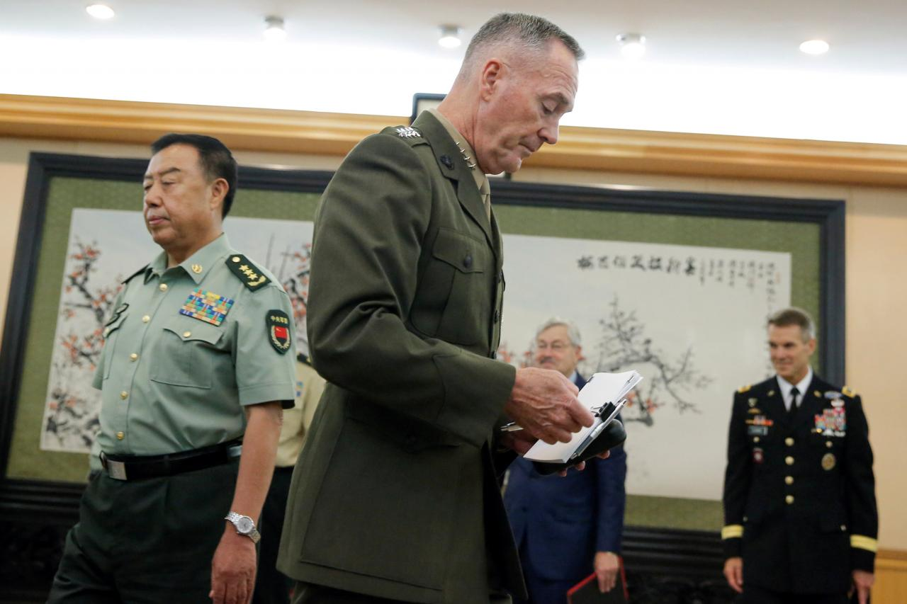 Chairman of U.S. Joint Chiefs of Staff Joseph Dunford (C) meets China's Central Military Commission Vice Chairman Fan Changlong (L) at the Bayi Building in Beijing, China, August 17, 2017.   REUTERS/Thomas Peter